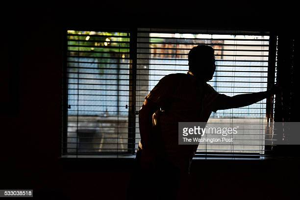Keith Gartenlaub adjusts blinds to maintain privacy inside his home in Southern California on Wednesday March 23 2016 Gartenlaub has been charged...
