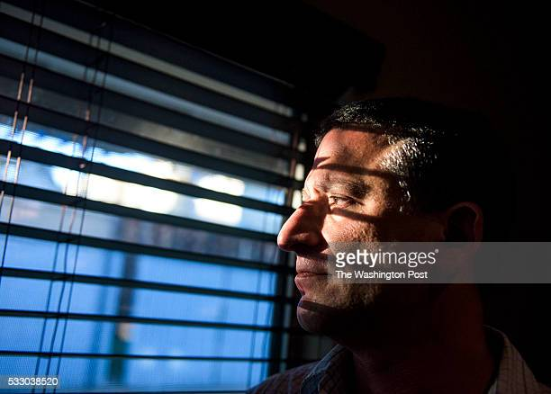 Keith Gartenlaub peers through blinds in the living room of his home in Southern California on Wednesday March 23 2016 Gartenlaub has been charged...