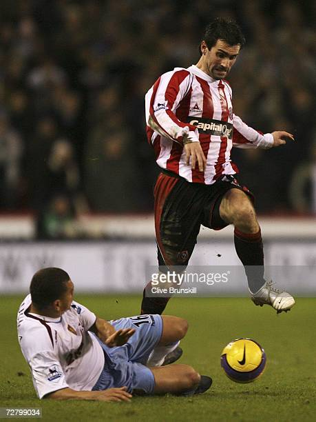 Keith Gillespie of Sheffield United is tackled by Wilfred Bouma of Aston Villa during the Barclays Premiership match between Sheffield United and...
