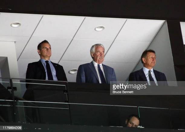 Keith Gretzky Bob Nicholson and Ken Holland of the Edmonton Oilers watch the game against the New York Islanders at NYCB's LIVE Nassau Coliseum on...