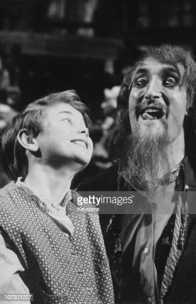 Keith Hamshere and Ron Moody star as Oliver and Fagin in the new musical 'Oliver' by Lionel Bart 30th June 1960 They are rehearsing at the New...