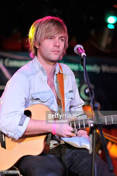 Keith Harkin of Celtic Thunder performs during an unplugged concert benefitting Hurricane Sandy victims at Sullivan Hall on December 3 2012 in New...