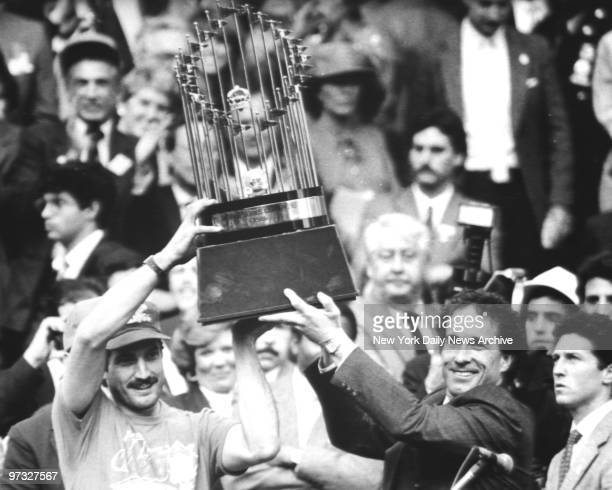 Keith Hernandez and Gary Carter hoist the World Series trophy at City Hall after New York Mets' parade