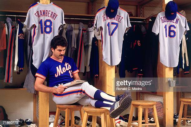 Keith Hernandez of the New York Mets reading in front of his locker in Shea Stadium in 1986 in Flushing New York