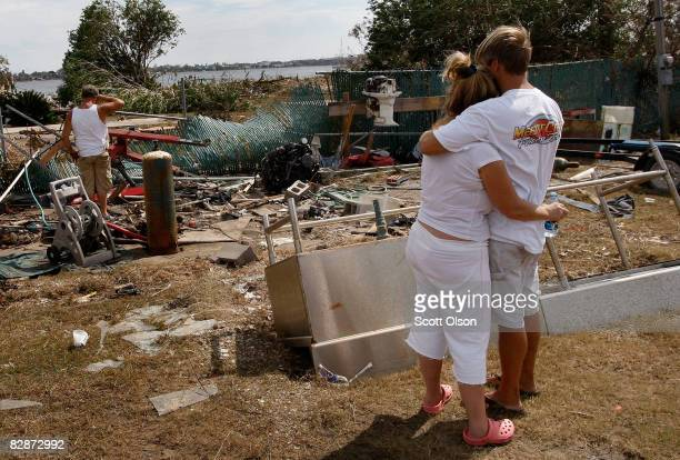 Keith Hinze embraces his wife Connie in front of the place where Keith worked before the building was swept away by Hurricane Ike September 15 2008...