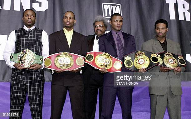 Keith Holmes , two-time World Boxing Council middleweight champion and Bernard Hopkins , International Boxing Federation middleweight champion, pose...