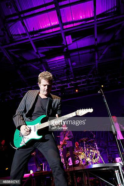 Keith Howland of the rock band Chicago performs during a free concert for those affected by the recent Illinois tornados at US Cellular Coliseum on...