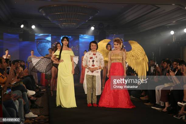 Keith Jackson walks the runway with Phapha Gachui Urmila Shalgosem during India Intimate Fashion Week at Hotel Leela on March 18 2017 in Mumbai India