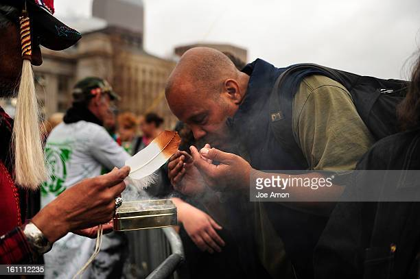 Keith Johnson Jr of Lakewood uses incense to cleanse the sprit of visitors to the Annual Denver 420 Rally in Civic Center Park Joe Amon The Denver...