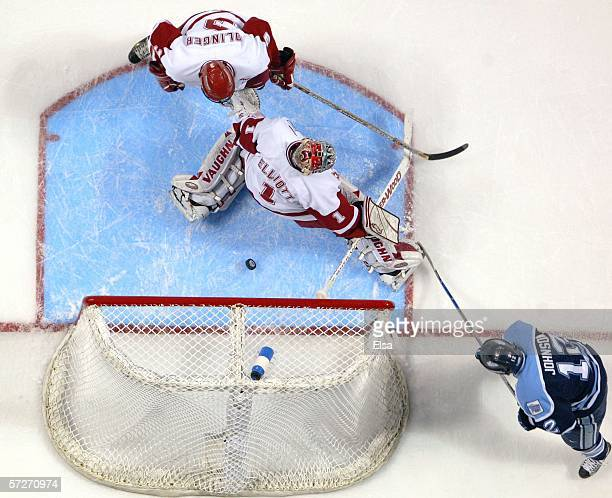 Keith Johnson of the Maine Black Bears slips the puck past Brian Elliott of the Wisconsin Badgers during the NCAA Frozen Four on April 6, 2006 at the...
