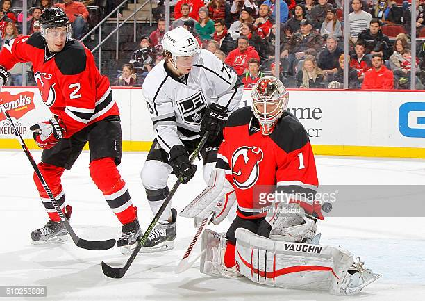 Keith Kinkaid and John Moore of the New Jersey Devils defends a scoring chance in the third period from Tyler Toffoli of the Los Angeles Kings at the...
