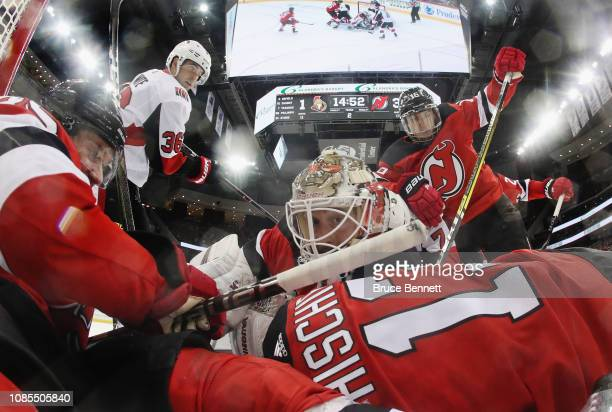 Keith Kinkaid and the New Jersey Devils defend the ne against the Ottawa Senators during the second period at the Prudential Center on December 21...