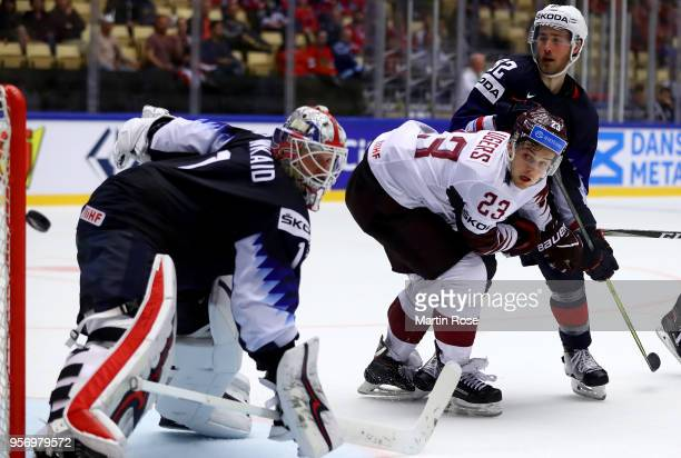 Keith Kinkaid goaltender of United States makes a save on Teodors Blugers of Latvia during the 2018 IIHF Ice Hockey World Championship Group B game...