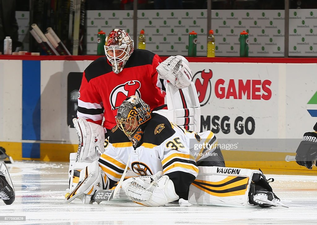 Keith Kinkaid #1 of the New Jersey Devils and Anton Khudobin #35 of the Boston Bruins stretch during warmups at Prudential Center on November 22, 2017 in Newark, New Jersey.