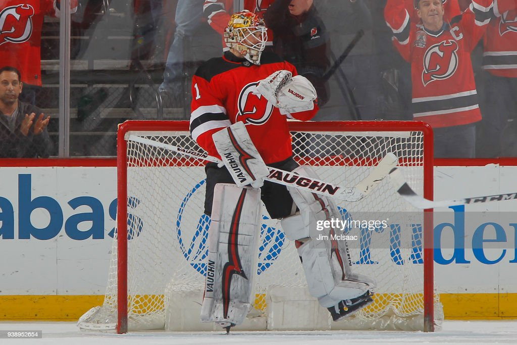 Keith Kinkaid #1 of the New Jersey Devils celebrates his team's win against the Carolina Hurricanes at the end of the third period on March 27, 2018 at Prudential Center in Newark, New Jersey. The Devils defeated the Hurricanes 4-3.