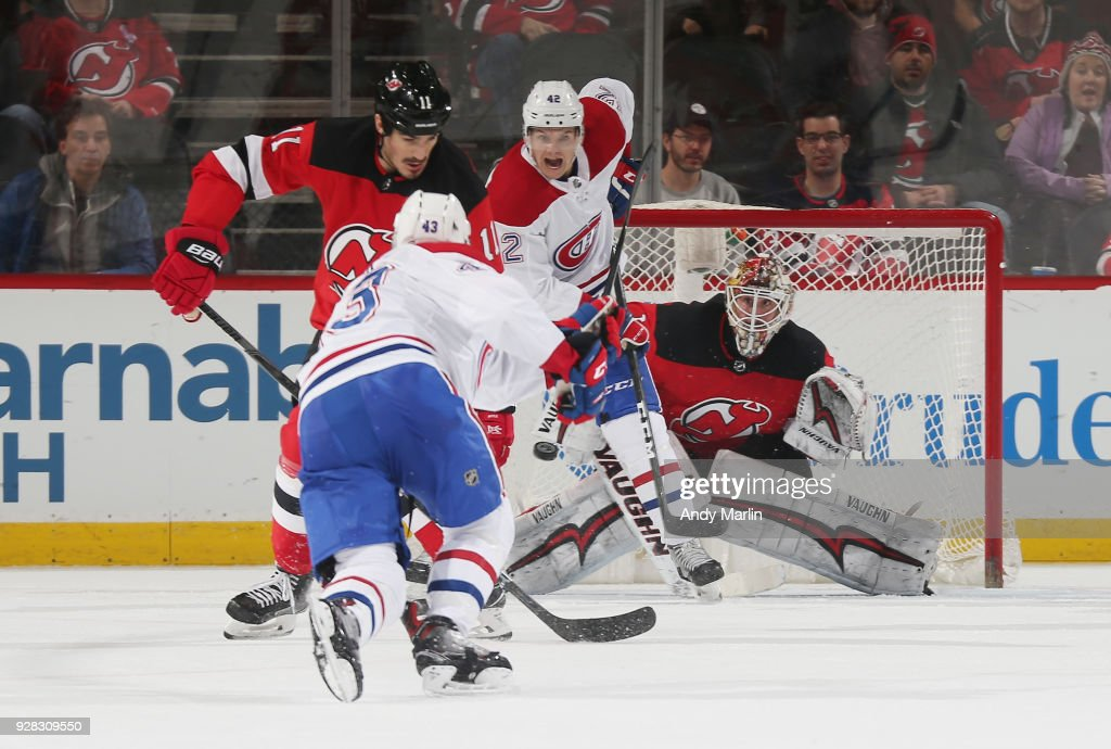 Keith Kinkaid #1 of the New Jersey Devils eyes the puck on a shot by Daniel Carr#43 of the Montreal Canadiens during the game at Prudential Center on March 6, 2018 in Newark, New Jersey.