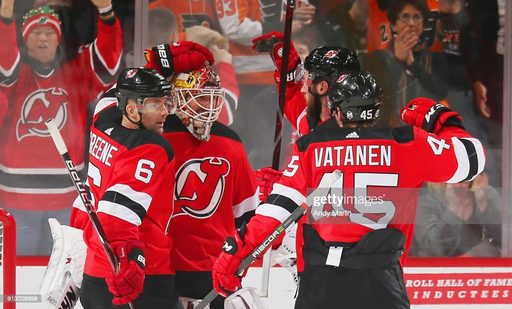 Keith Kinkaid #1 of the New Jersey Devils is congratulated after defeating the Philadelphia Flyers at Prudential Center on February 1, 2018 in Newark, New Jersey. The Devils defeated the Flyers 4-3.