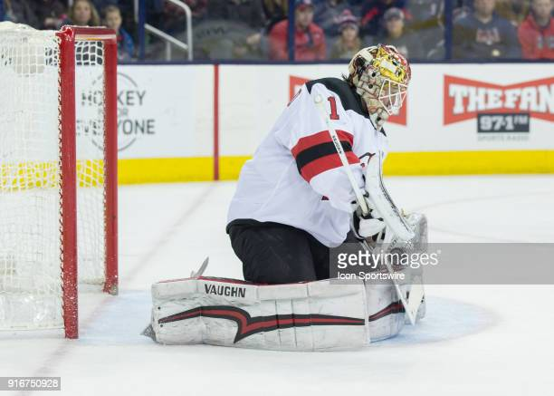 Keith Kinkaid of the New Jersey Devils makes a glove save during the second period of the game between the Columbus Blue Jackets and the New Jersey...