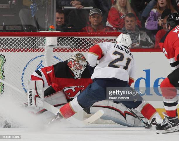 Keith Kinkaid of the New Jersey Devils makes the first period save on Vincent Trocheck of the Florida Panthers on the breakaway at the Prudential...