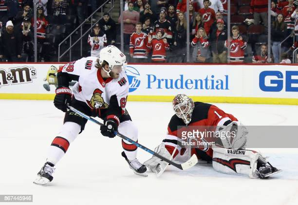 Keith Kinkaid of the New Jersey Devils makes the save on Mike Hoffman of the Ottawa Senators at the Prudential Center on October 27 2017 in Newark...