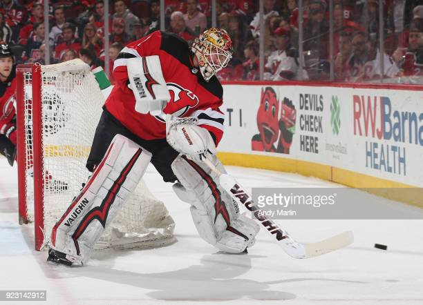 Keith Kinkaid of the New Jersey Devils plays the puck during the game against the Columbus Blue Jackets at Prudential Center on February 20 2018 in...