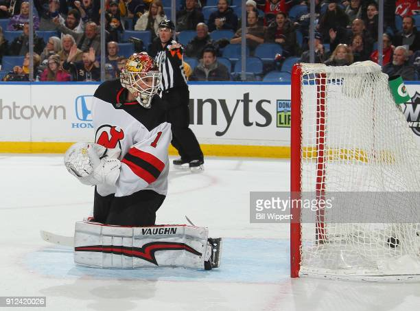 Keith Kinkaid of the New Jersey Devils reacts to a third period goal by Jake McCabe of the Buffalo Sabres during an NHL game on January 30 2018 at...
