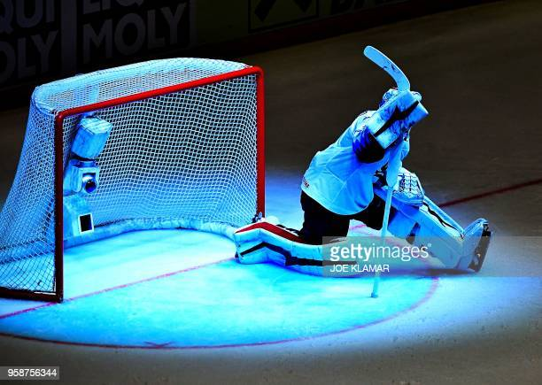 TOPSHOT Keith Kinkaid of the United States remains kneeling after receiving a goal from Finland during the group B match Finland vs the United States...