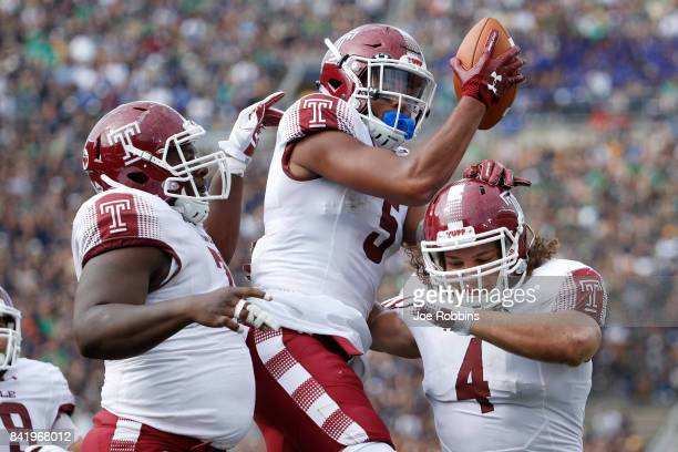 Keith Kirkwood of the Temple Owls celebrates with teammates after a 12yard touchdown reception against the Notre Dame Fighting Irish in the second...