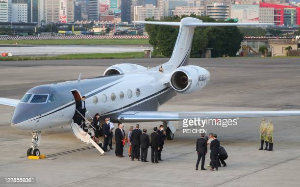 Keith Krach , US Undersecretary of State for Economic Growth, Energy and the Environment, alights from an aircraft with his delegation after landing...