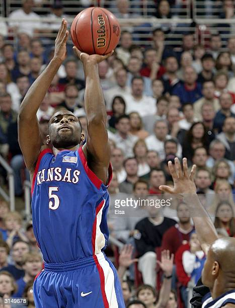 Keith Langford of the Kansas Jayhawks takes a shot in the first half against the Georgia Tech Yellow Jackets during the fourth round game of the NCAA...