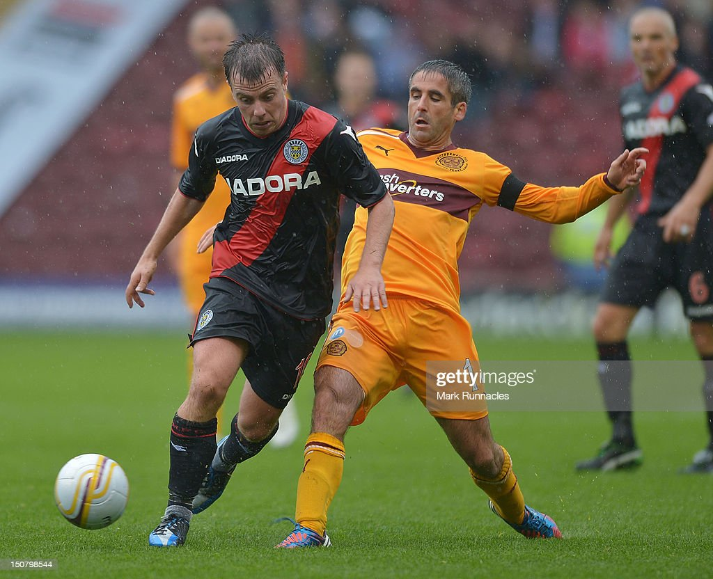 Keith Lasley of Motherwell competes with Paul McGowan of St Mirren during the Clydesdale Bank Scottish Premier League match between Motherwell and St Mirren at Fir Park on August 26, 2012 in Motherwell, Scotland.