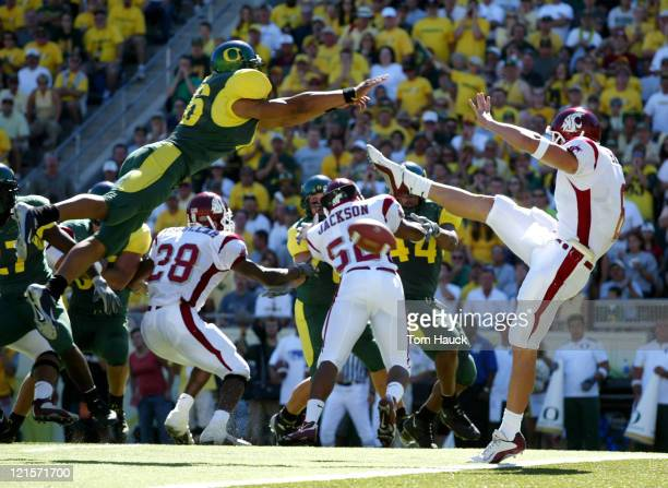 Keith Lewis of the Oregon Ducks blocks the punt of Kyle Bessler of the Washington State Cougars at Autzen Stadium in Eugene Oregon Oregon lost to...