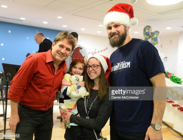 Keith Lockhart and Sebastian Vollmer with Grace and Mom after the Boston Pops Holiday Concert at Boston Children's Hospital December 12 2017 in...