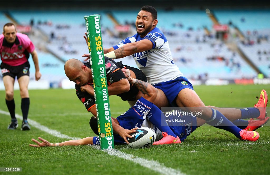 Keith Lulia of the Tigers scores a try during the round 19 NRL match between the Wests Tigers and the Canterbury Bulldogs at ANZ Stadium on July 20, 2014 in Sydney, Australia.