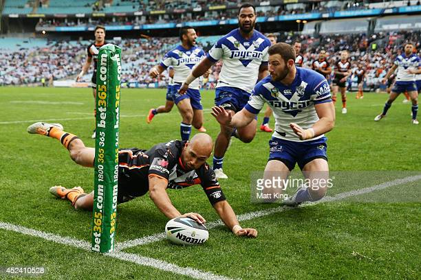 Keith Lulia of the Tigers scores his second try during the round 19 NRL match between the Wests Tigers and the Canterbury Bulldogs at ANZ Stadium on...