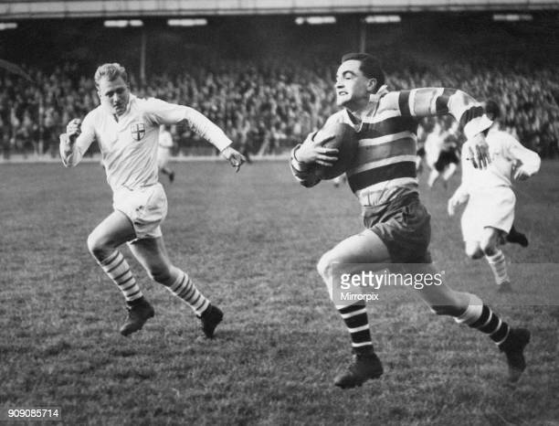 Keith Maddocks Neath Rugby Union Player match action in a race for the London Counties line being headed off by J E Woodward of Wasps in the London...