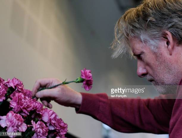 Keith Mastaglio makes the finishing touches to his display of Carnations during staging day for the Harrogate Autumn Flower Show on September 12 2019...
