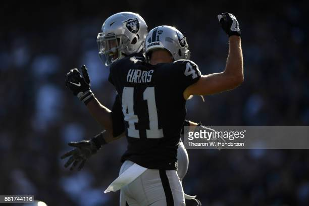 Keith McGill and Erik Harris of the Oakland Raiders react after a play against the Los Angeles Chargers during their NFL game at OaklandAlameda...