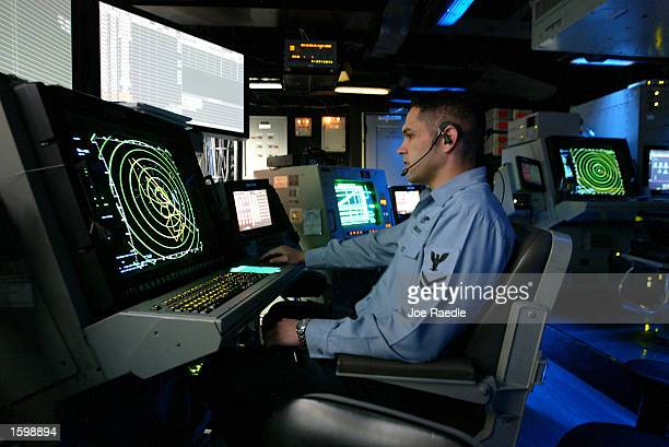 Keith Miller from Chandler Arizona works in front of a radar screen in the Carrier Air Traffic Control Center aboard the USS Abraham Lincoln November...