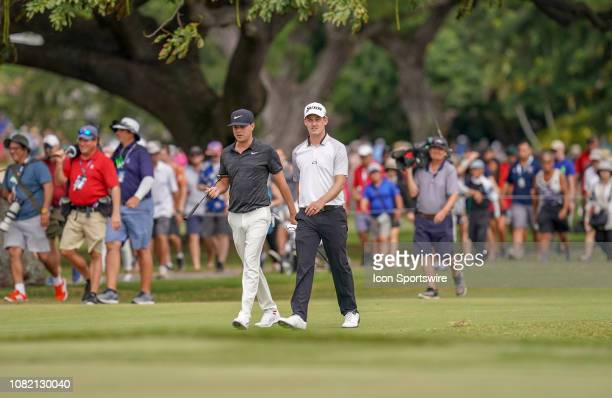 Keith Mitchell and Andrew Putnam walk up the fairway on the 3rd hole during the final round of the Sony Open on January 13 at the Waialae Country...
