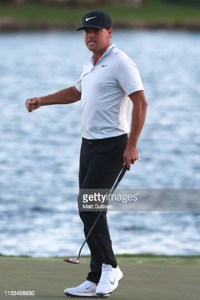 Keith Mitchell celebrates after making a birdie putt on the 18th green to win the Honda Classic at PGA National Resort and Spa on March 03 2019 in...