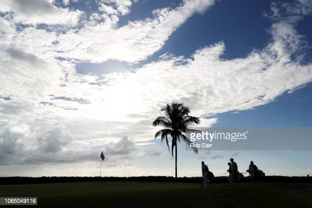 Keith Mitchell of the United States Anirban Lahiri of India and Tyler Duncan of the United States walk to the 15th green during the first round of...