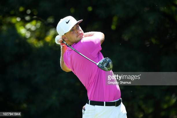 Keith Mitchell of the United States plays his shot from the 13th tee during the first round of the BMW Championship at Aronimink Golf Club on...