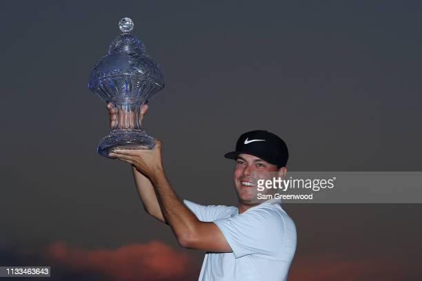 Keith Mitchell poses with the trophy after winning the Honda Classic at PGA National Resort and Spa on March 03 2019 in Palm Beach Gardens Florida