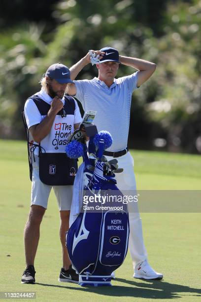 Keith Mitchell talks with his caddie before playing his second shot on the sixth hole during the third round of the Honda Classic at PGA National...