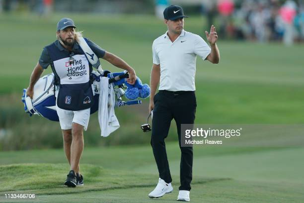 Keith Mitchell waves to the crowd as he walks up the 18th fairway during the final round of the Honda Classic at PGA National Resort and Spa on March...