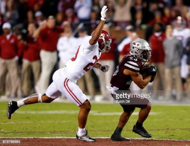 Keith Mixon of the Mississippi State Bulldog catches a pass as Minkah Fitzpatrick of the Alabama Crimson Tide tries to tackle him during the second...