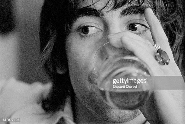 Keith Moon Drinking Beer at Home