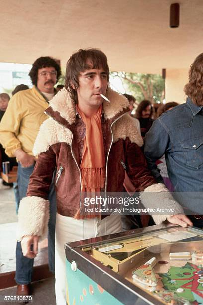 Keith Moon drummer for The Who plays pinball at the International Pinball Tournament an event coinciding with the opening of the group's rock opera...