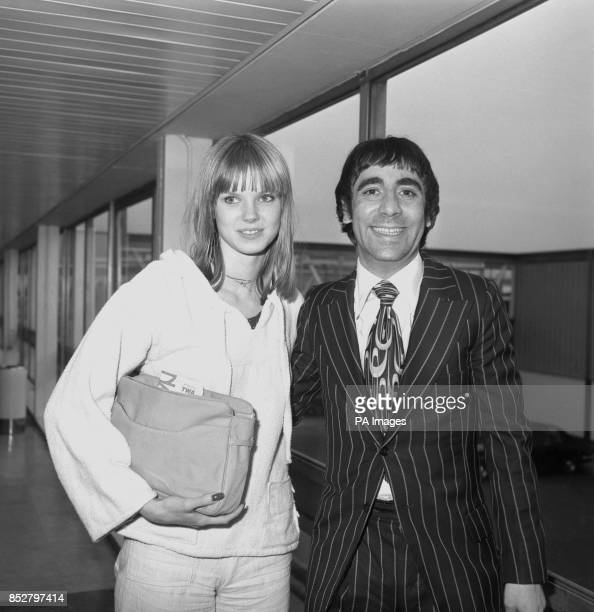 Keith Moon drummer of rock band The Who and his girlfriend Annette WalterLax land at Heathrow Airport in London after travelling from Los Angeles...